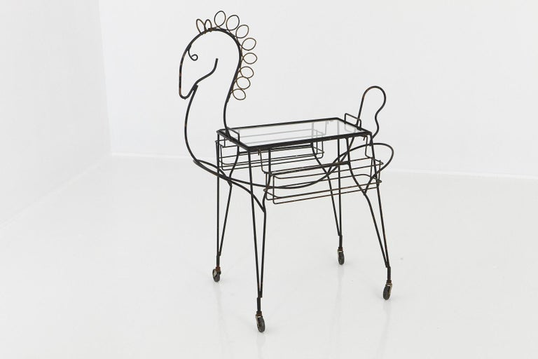 John Hollister Risley (1919-2002) black wrought iron bar cart in the design of a horse, complete with two removable bottle holders on each side and a removable glass tray on casters, circa 1955.