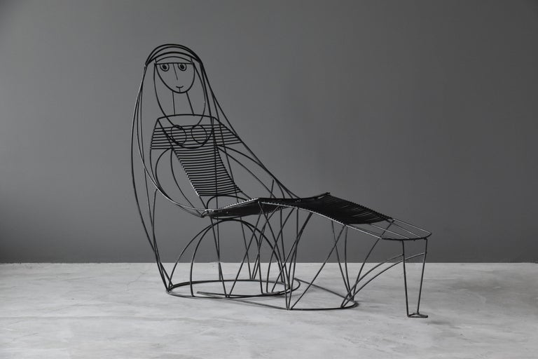 A lounge chair and ottoman or chaise lounge, designed by American designer John Risley. Risley's designs were produced at his Connecticut studio. He also worked as a sculptor and a professor of art at Wesleyan College in Connecticut.
