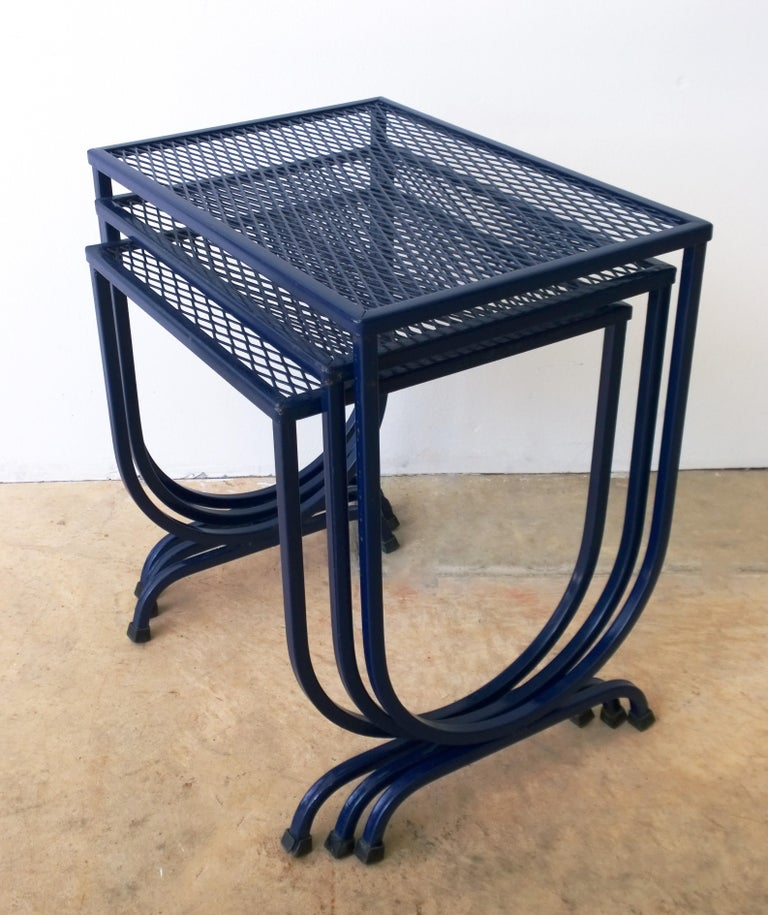Offered is Mid-Century Modern set of three John Salterini outdoor wrought iron patio / garden stacking / nesting tables newly enameled in navy blue. The stacking tables are easy to move around; however, they are quite sturdy. Wonderful for outdoor