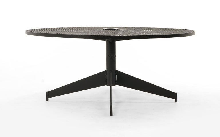 Patio or pool or outdoor coffee table by the John Salterini company, 1960s. The center has an opening for an umbrella. This has been expertly media blasted and powder coated. The tabletop shows some indentations in the top, but no major distraction.