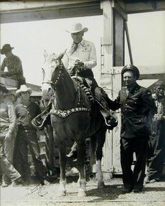 Mr. Everett Colborn of Dublin, Texas (mounted) and Flight Officer Gene Autry