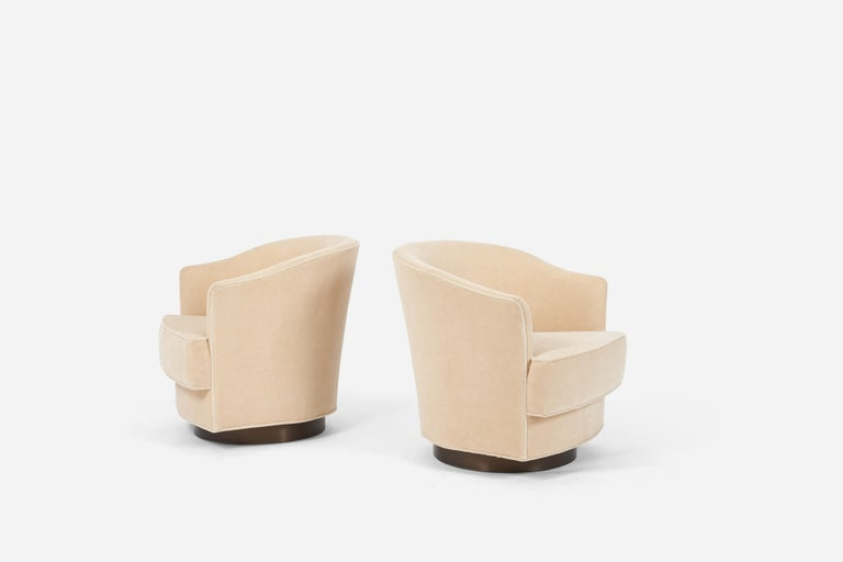 Pair of swivel chairs by John Stuart, circa 1960s. Model #2150. Fully restored. New mohair upholstery over dark bronze swivel bases.