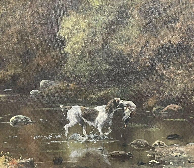 Artist/ School: John Trickett (British, b. 1953), signed.  Title: Spaniel with dead game in river landscape.  Medium:  oil painting on canvas, framed.  Size:  painting: 10 x 18 inches, frame: 14.75 x 22.75 inches  Provenance: private collection on