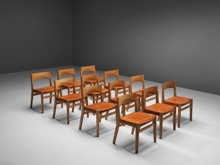 JohnVedel-Rieper forErhard Rasmussen, set of 12 dining chairs, oak, leather, Denmark, 1957.  Danish designer John Vedel-Rieper created this dining chair in 1957 for Erhard Rasmussen. The strong lines and the well-designed proportions as well as