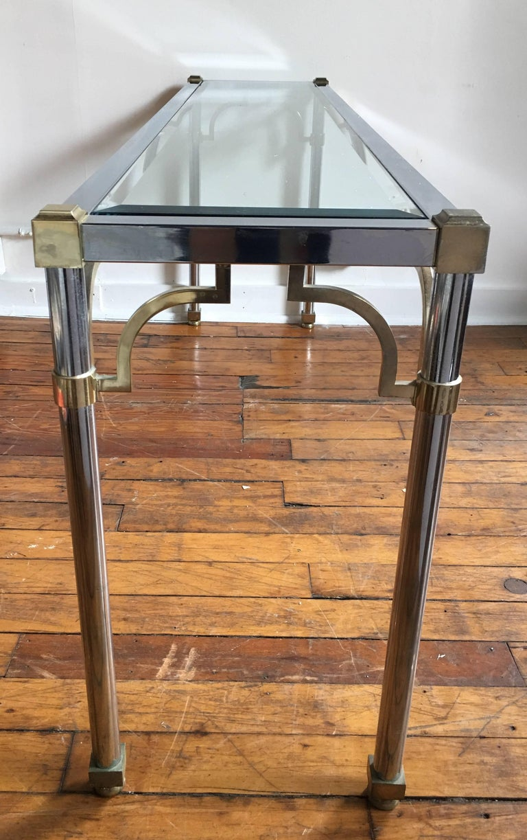 Mid-Century Modern mixed metal brass and chromed steel console sofa table in the style of John Vesey and Maison Jansen. Removable clear beveled glass top. Coordinating coffee table also available for purchase.