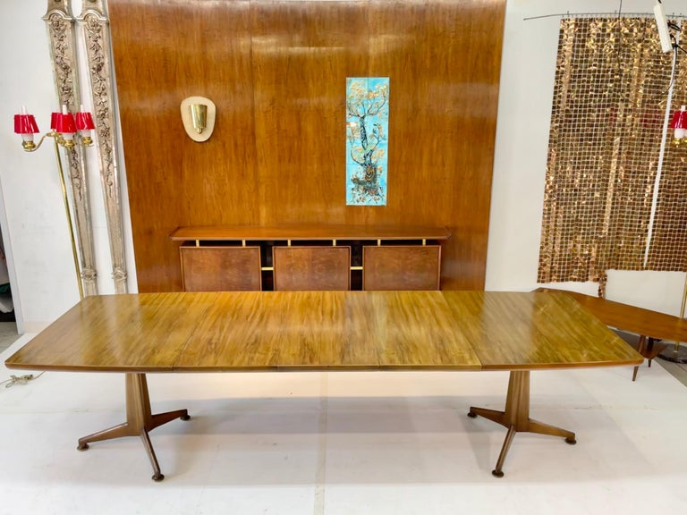 After a long and storied career J. Stuart Clingman joined John Widdicomb Furniture Company as chief designer in 1952.  In 1956 he designed the Mid-Century Modern series for John Widdicomb including this table, model 2599.  He died later that same