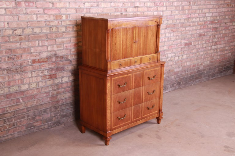 A gorgeous midcentury French Regency style 10-drawer tambour door highboy dresser chest  By John Widdicomb  USA, circa 1960s  Cherry and burl wood, with original brass hardware.  Measures: 38