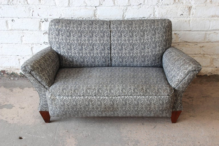 An extremely rare Mid-Century Modern salesman sample or child's sofa by John Widdicomb. It was originally made for traveling salespersons to bring along as samples when selling furniture. The sofa features sleek midcentury lines, solid walnut feet,