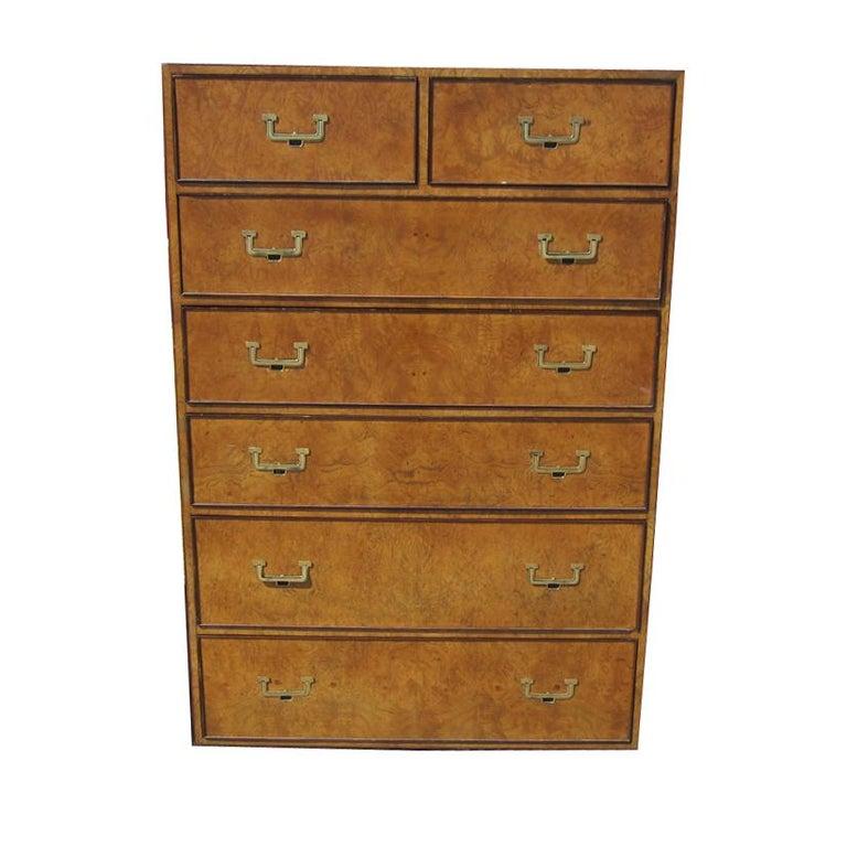 A prime piece of furniture in burled elm veneer (over oak wood) by John Widdicomb. Dresser features Inset brass pulls in the