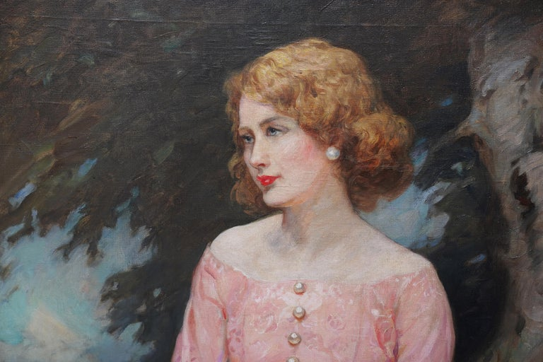 A large stunning three-quarter length portrait of a young woman in a pink dress.  It is titled Jonne and was painted in 1930. This original oil on canvas in its fine original gilt acanthus leafed frame was painted by John William Schofield, a noted