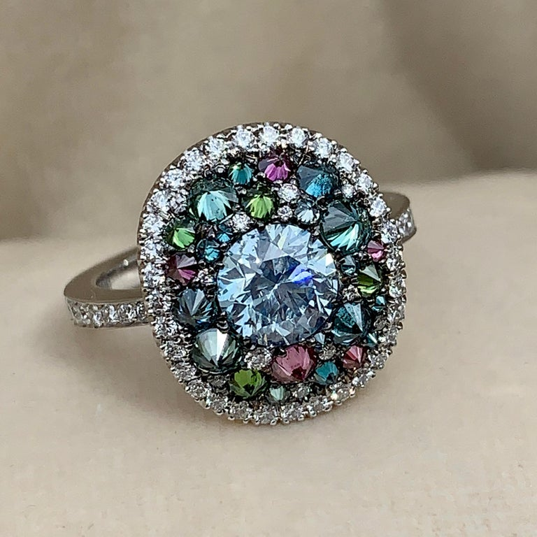 One of a kind ring in 18K White gold 6,9 g set with a natural coloured blue diamond centerstone 1,07 carat., white DEGVVS diamonds, Upside down set natural coloured Blue, green & purple diamonds 1,42 ct. Total diamonds: 2,49 carat. Size EU 53 US 6,3