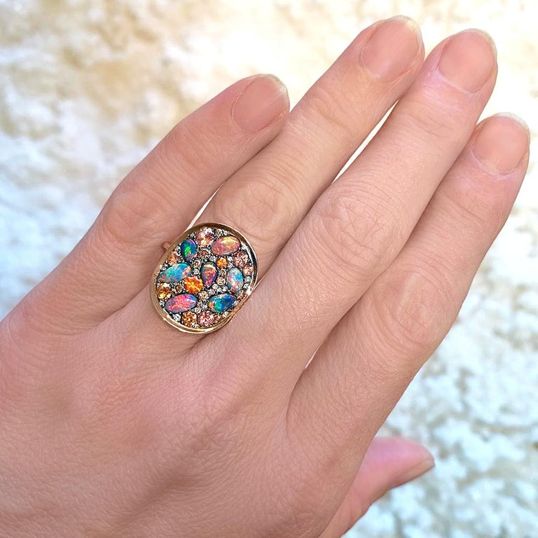 One of a Kind Starstruck Ring handcrafted in Belgium by jewelry maker Joke Quick in high-polished 18k rose gold featuring a curved oval element in blackened sterling silver set with an assortment of spectacular natural gemstones, including