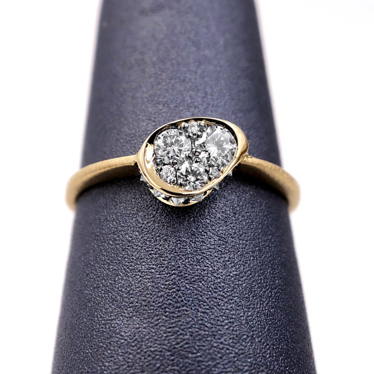 Innervisions Ring handmade in Belgium by jewelry designer Joke Quick in matte-finished 18k yellow gold featuring superior-quality DE/vvs round brilliant-cut white diamonds in the center with inverted white diamonds along the sides totaling 0.25