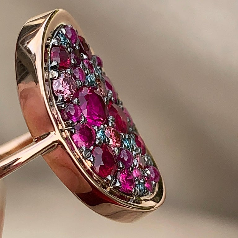 One of a kind ring in 18K rose gold 4,7 g & blackened sterling silver (The stones are set on silver to create a black background for the stones) Pave set with brilliant-cut rubies 0,80 ct. , pink sapphire cabochons, 0,13 ct. Natural colored pink