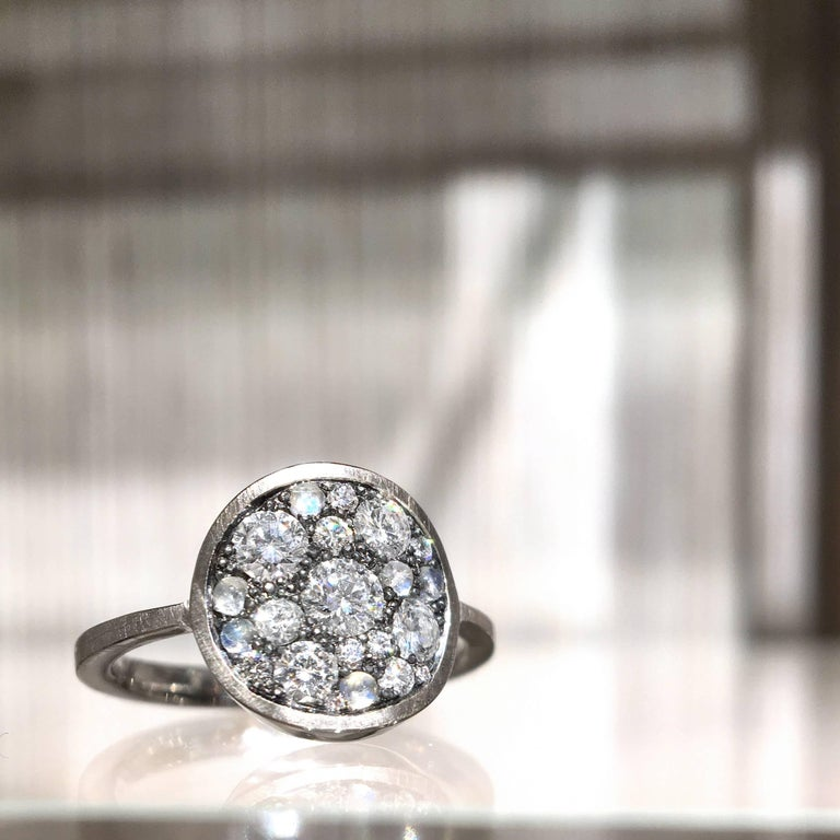 Starstruck Ring handmade by jewelry designer Joke Quick featuring 0.59 total carats of round brilliant-cut white diamonds and accented with six blue moonstone cabochons, all mounted in a curved oxidized sterling silver disc and set on a