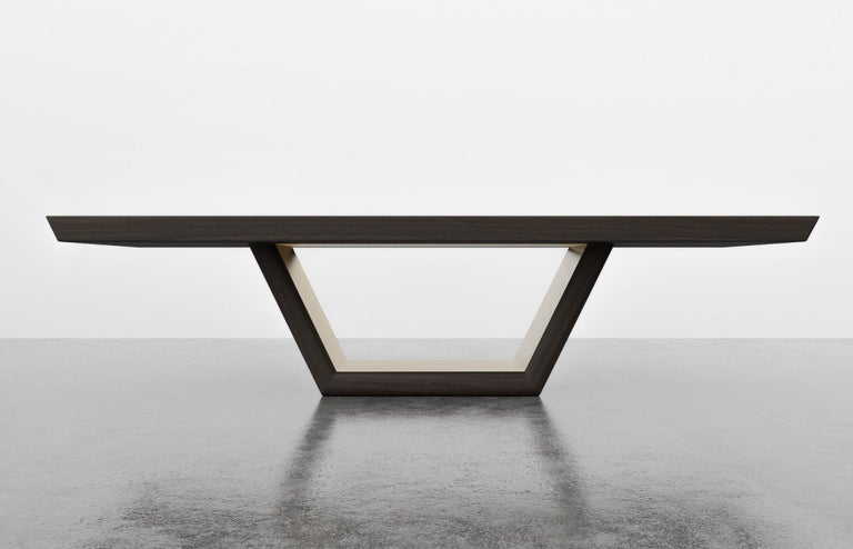 The Jolie dining table is an extension of our Jolie Console. Angular and sculptural. As featured in ebony oak with polished bronze metal inlay $16,540. Starting at $14,780.00. Fully custom and made to order in California.