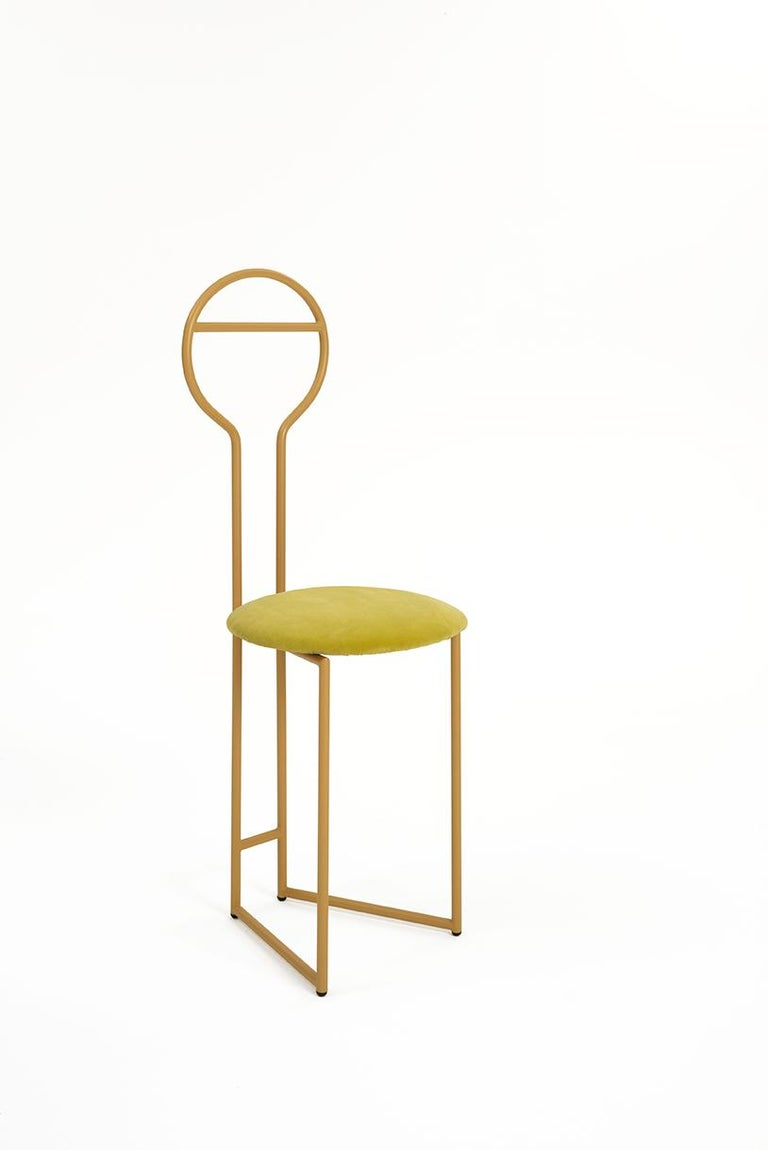 Joly Chairdrobedesign Lorenz + Kaz, 2019 Made of gold powder-coated metal with padded cushion seat in green velvet fire class E1 (the listed version) . Available in 4 different fabric categories, including linen, felt, leather, eco-leather,