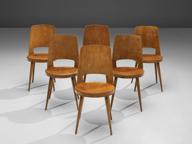 Jomaine Baumann, large set of 'Mondor' dining chairs, plywood, wood, France, 1960s