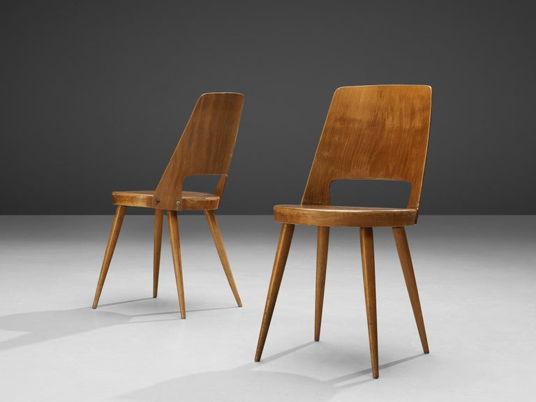 Jomaine Baumann, large set of 'Mondor' dining chairs, plywood, wood, France, 1960s  The 'Mondor' dining chair was manufactured by French furniture maker Jomaine Baumann. Characteristic for the 'Mondor' chair is the curved bentwood back with a