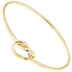 Jona 18 Karat Yellow Gold Knot Bangle Bracelet