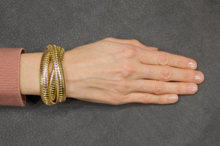 Alex Jona design collection 18k yellow gold Tubogas Rolling Bracelet. Designed and hand crafted in Italy.   Dimensions (Each band) : Diameter 2.26 in X Width 0.45 in X D 0.18 in - Diameter 57 mm X Width 12 mm X D 4.81 mm. Also available in larger