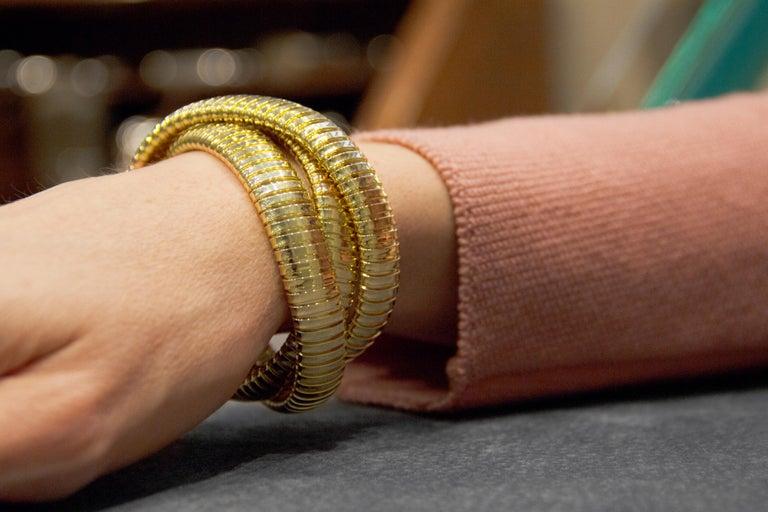 Women's Alex Jona 18 Karat Yellow Gold Tubogas Rolling Bracelet For Sale