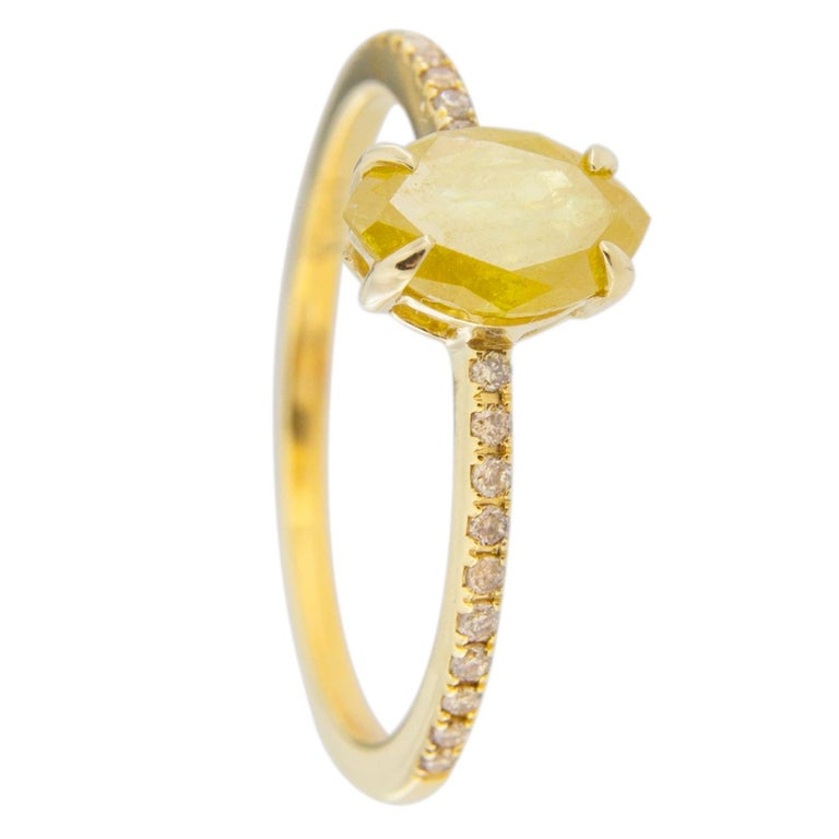 Jona design collection, hand crafted in Italy, 18 karat yellow gold solitaire ring centering an intense fancy yellow marquise cut diamond weighing 0.80 carats. The shoulders are set with 20 round cut brown diamonds, F color,  weighing 0.12 carats in