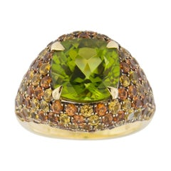 Jona Peridot Orange Yellow Sapphire 18 Karat Yellow Gold Dome Ring