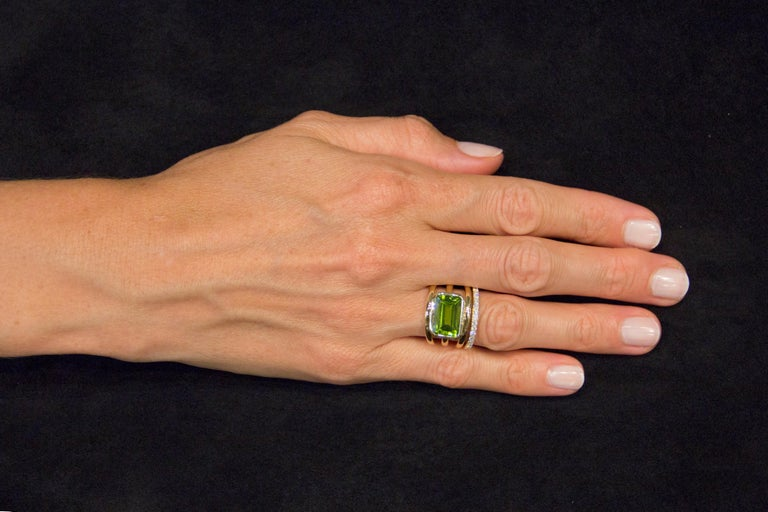 Jona design collection, hand crafted in Italy, 18 karat yellow gold band ring set with a 5.92 carat emerald cut Peridot and 0.40 carats of white diamonds. Dimension : H 0.93 in / 23.74 mm X W 0.86 in / 22.06 mm X D 0.22 in/ 5.80 mm All Jona jewelry