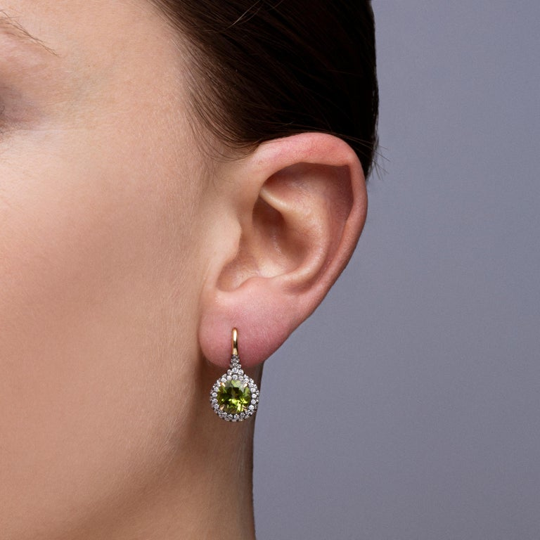 Alex Jona design collection, hand crafted in Italy, 18 karat yellow gold stud earrings set with two round cut peridot  weighing 4.12 carats, surrounded by 152 white diamonds, F color, VVS1 clarity, weighing 1.54 carats in total.  Dimensions :  Alex