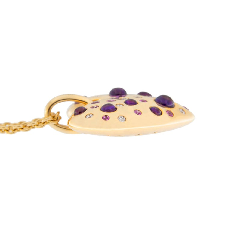 Jona design collection, hand crafted in Italy, 18 karat pink gold bombé heart pendant set with Pink Sapphires (ct. 0.37), Cabochon Amethysts (Ct 1.35) and White Diamonds (ct. 0.18), mounted either on a pink silk fabric chain or a pink gold long