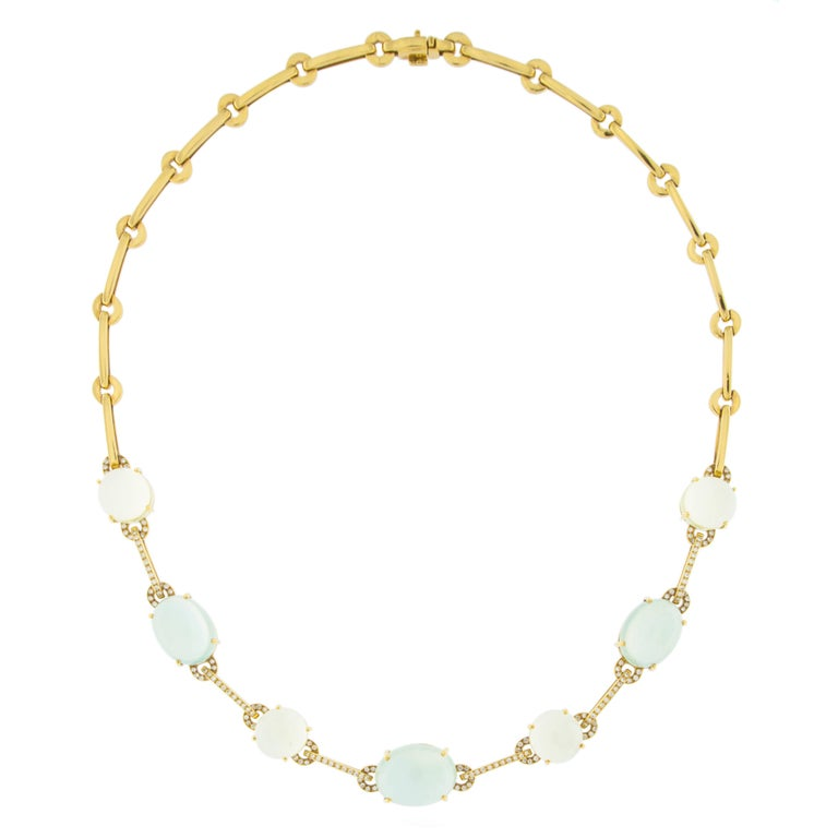 Jona Design collection, 18 karat yellow gold necklace consisting of 3 Prehnite oval cabochons weighing 35.52 carats and 4 round Citrine cabochons weighing 22.46 carats, linked by gold link bars featuring 0.85 carats of white diamonds. Designed and