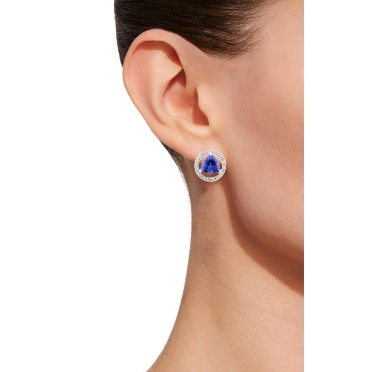 Jona design collection, hand crafted in Italy, 18 karat white gold stud earrings set with two triangle cut Tanzanite weighing 3.94 carats, surrounded by 60 brilliant cut white diamonds, F COLOR, VVS1 clarity weighing 0.39 carats. Dimensions: