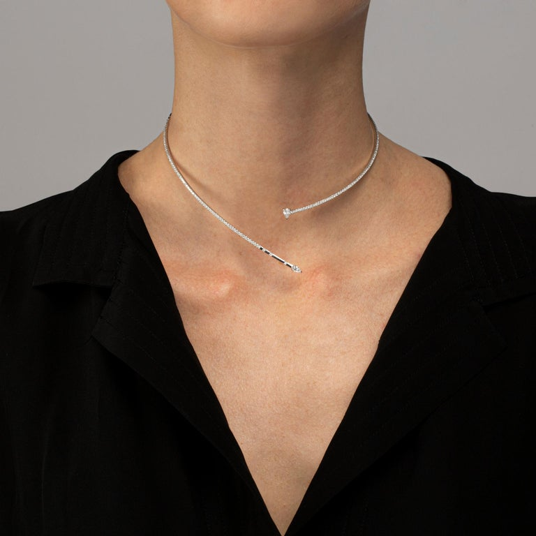 Jona design collection, hand crafted in Italy, 18 karat white gold diamond flexible choker necklace. A smooth narrow open ring is set with 159 brilliant cut diamonds weighing 1.39 carats. It ends on each side with a drop shape white diamond weighing