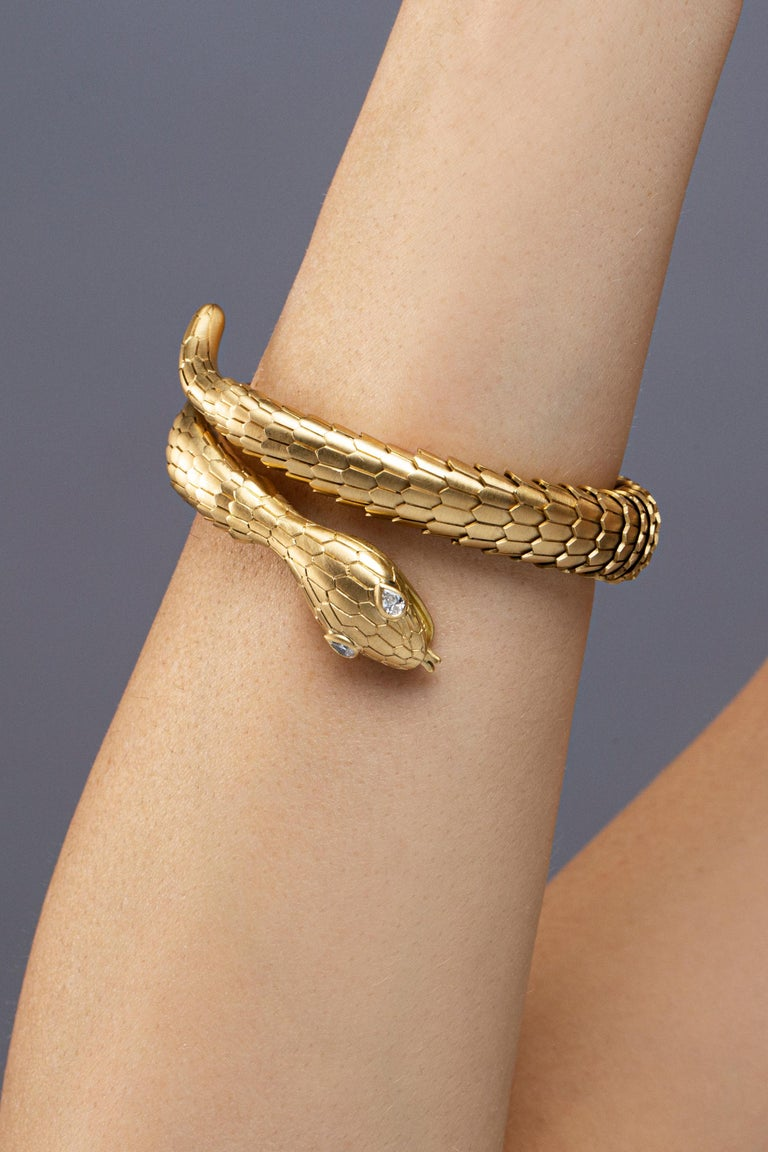 Jona design collection, hand crafted in Italy, 18 karat brushed yellow gold flexible coil snake bracelet. Two drop cut diamonds weighting 0.19 carats set on the head of the serpent. The body made of flexible scaled brushed gold links. Dimensions: H