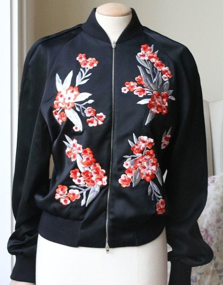 Cut from fluid black satin, Jonathan Saunders' 'Cecily' bomber is intricately embroidered with a contrasting poppy pattern and is designed for relaxed, slouchy fit. Black satin. Red and pastel-pink floral embroidery, slit pockets, pastel-pink