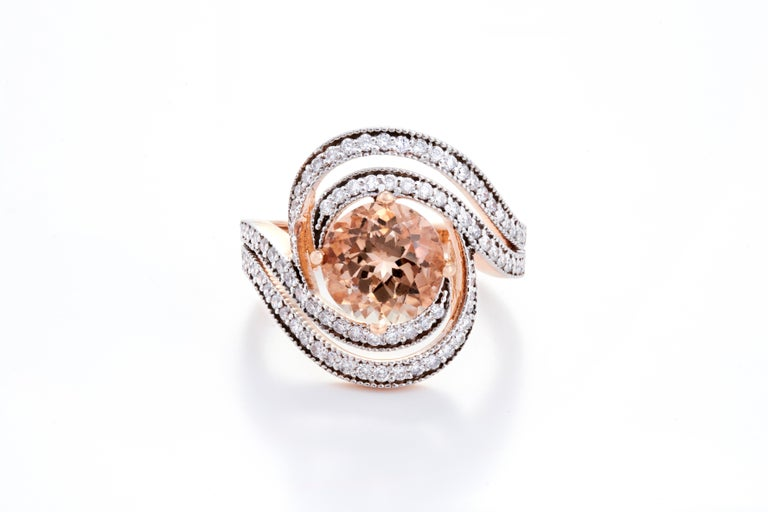 Set in 5.83 grams of 18K Rose Gold with 90 round cut diamonds around the Gemstone VS/G quality and colour weighing 0.57 carats.   These diamonds and gemstones have been carefully picked and selected from authentic sources and complete importance has