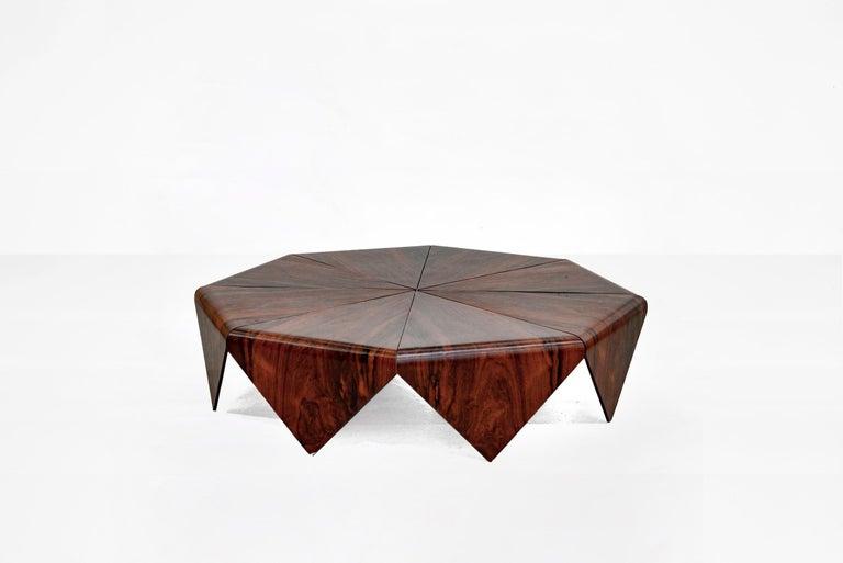 "Jorge Zalszupin (1922-)  Coffee table model ""Petalas"" Manufactured by L'Atelier Brazil, 1960s Jacaranda, iron structure  Measurements 140 cm diameter x 32 cm height 55.11 in diameter x 12.59 in height  Literature Maria Cecilia Loschiavo"