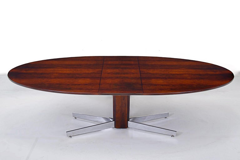 Brazilian rosewood dining table with stored leaf on chrome pedestal base. Designed by Jorge Zalszupin for L'Atelier. Brazil, 1960. Fully restored/refinished. Top measures: 95