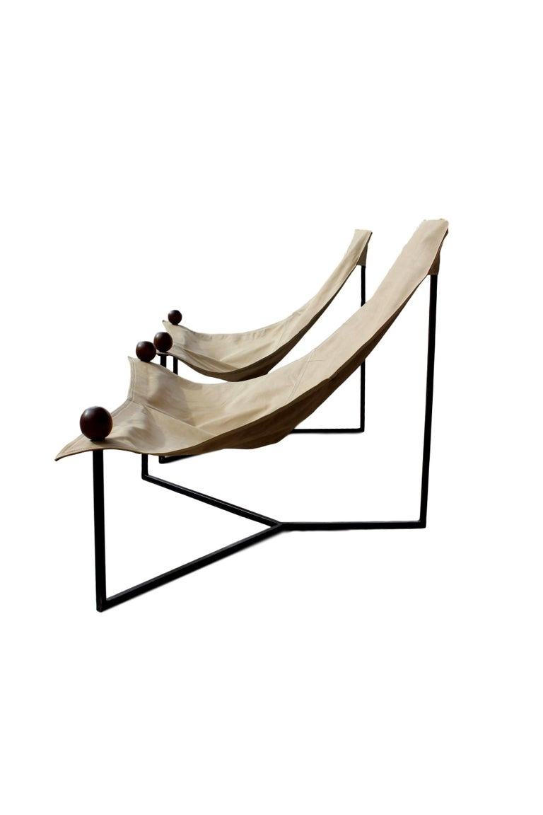 This striking off-white 'Poltrona Triangular' lounge chair was designed by the master of Brazilian modernist design, Jorge Zalszupin. It features 3 legs made of iron, leather seating, and Jacaranda wood end caps.  A Brazilian émigré of Polish