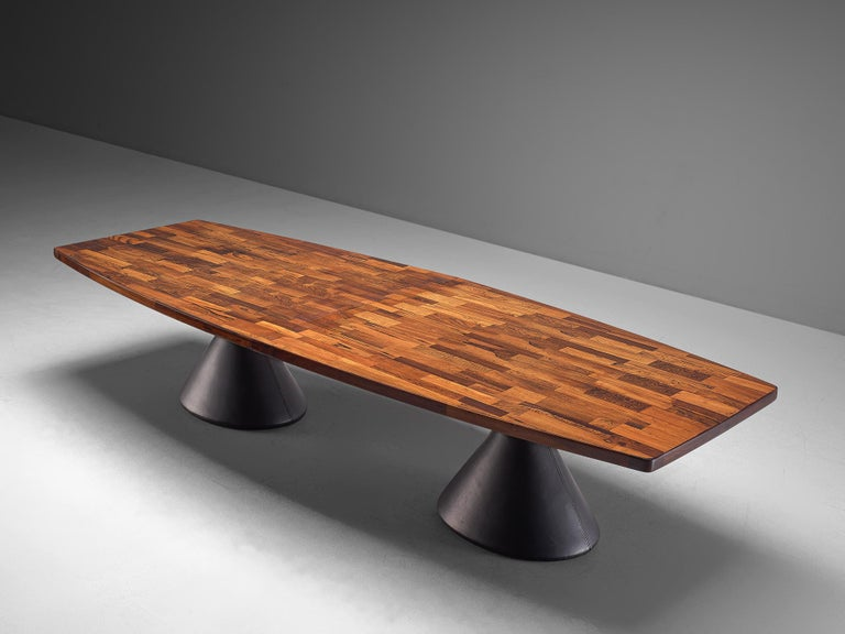 Jorge Zalszupin for L'Atelier, large dining table 'Guanabara,' in rosewood, leather, metal and concrete, Brazil, 1960s.   Conference table in Brazilian Jacaranda by designer Zalszupin. The table features a very large boat-shaped top on two pillar