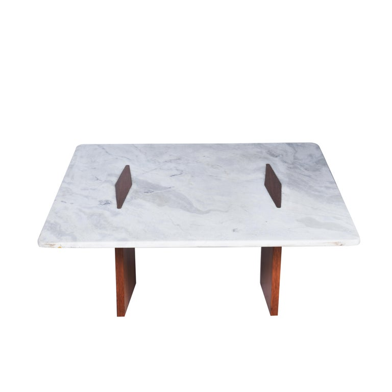 Jorge Zalszupin midcentury Brazilian center table with marble top and Perobinha do Campo Structure, 1960s.  With an elegant design, this beautiful marble-top coffee table is supported by two strong bases in wood veneered wood Perobinha do Campo.