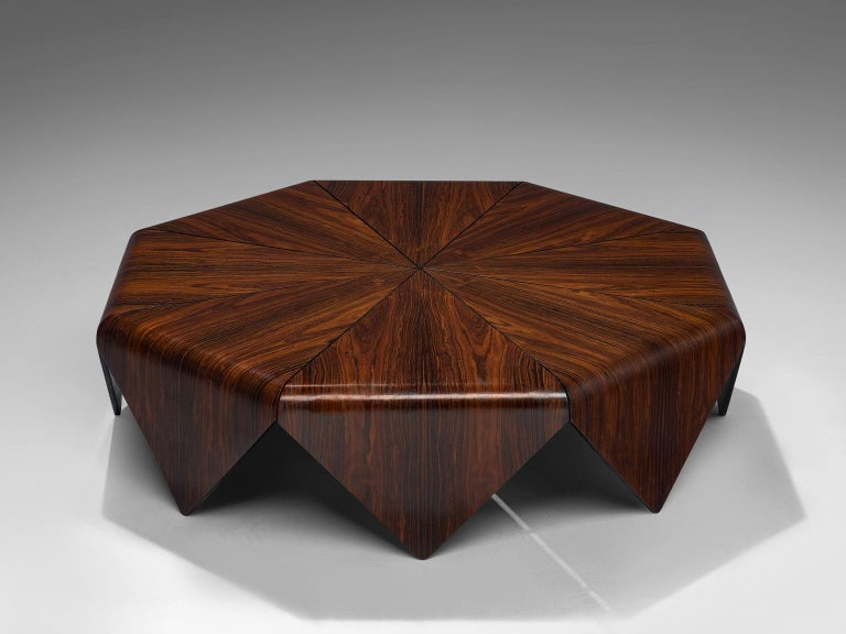 Jorge Zalszupin for L'Atelier, coffee table, Jacaranda rosewood, Brazil 1960s.   The 'Pétalas' coffee table is a design by Jorge Zalszupin, inspired by a folded paper structure of origami. The rosewood coffee table consists of 8 diamond-shaped