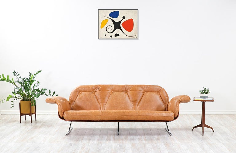 "Iconic ""Presidencial"" sofa designed by Jorge Zalsupin for L'Atelier in Brazil, circa 1960s. This rare and sophisticated sofa is comprised of a rosewood frame and enameled steel and chrome-plated steel sled legs. The incorporation of various"