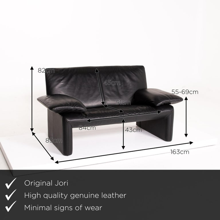 We present to you a JORI leather sofa black two-seat couch.
