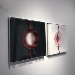 Red filled Moons - kinetic wall sculpture by J. Margulis