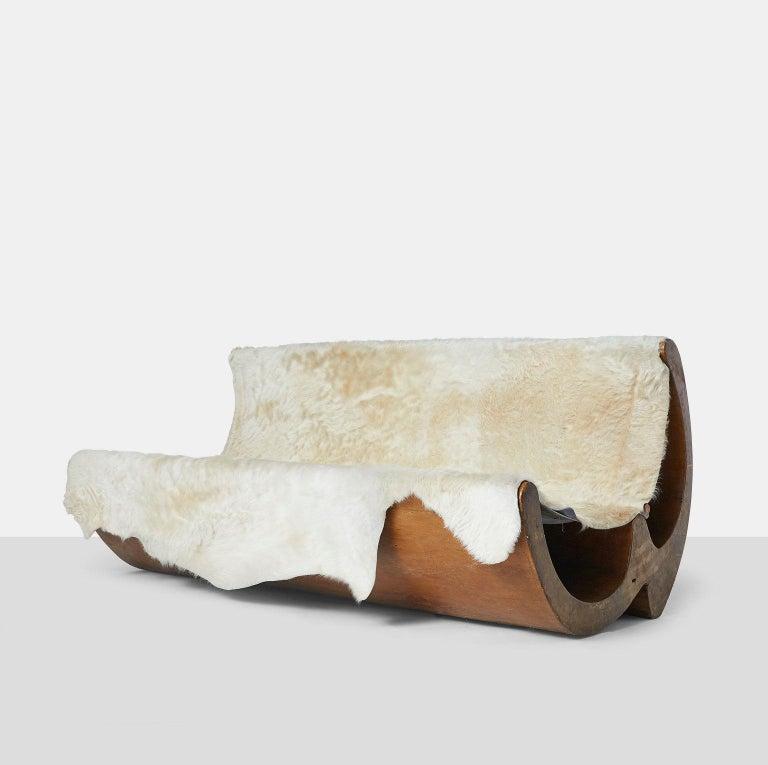 """Jose Zanine Caldas sofa A collectible and rare sofa by Jose Zanine Caldas in carved wood using a single hide for the seat and back. The side is branded with """"Zanine"""". Brazil, circa 1970. Lierature: Suely Ferreira da Silva, Zanine: Sentir e Fazer,"""