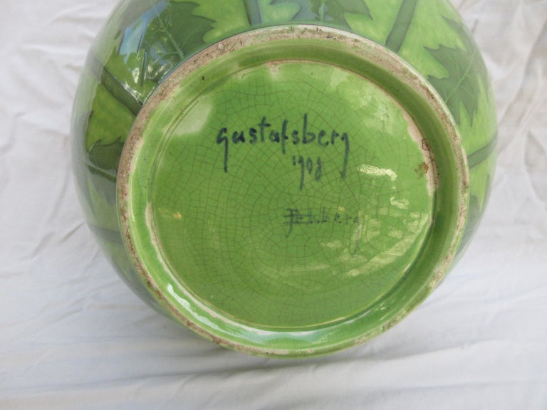 This is a handmade vase, a very rare 2-tone Green one. The only one of its kind. Signed and dated, J-Ekberg 1908. A Swedish Artist that started working for the Gustavsberg Ceramic Foundry in Stockholm Sweden in 1898 and worked there till his death