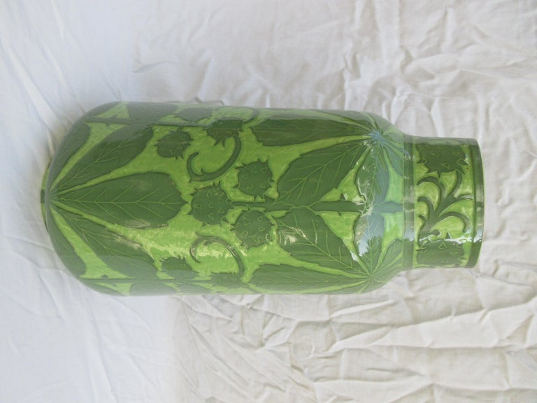 This is a handmade vase, this is a very rare 2 tone green. The only one of its kind. Signed and dated, J-Ekberg 1908. A Swedish Artist that started working for the Gustavsberg Ceramic Foundry in Stockholm Sweden in 1898 and worked there till his