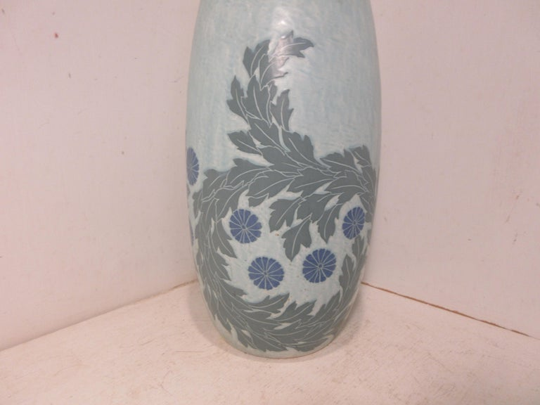 This is a handmade, 1 off Sgraffito vase made by the Swedish ceramic artist Josef Ekberg in 1911. he was one of Sweden's Top Ceramic artist at the time. He started working at the Gustavsberg foundry in 1898 till his death in 1945. His works are
